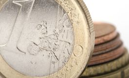 One Euro and Coins stock images