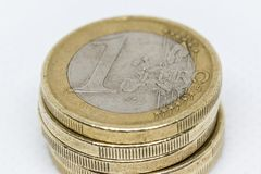 One euro coins Stack. Five euro coins forming a column and white background stock photo