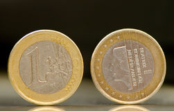 One euro. One Nederlanden euro coins on black background Stock Photos
