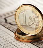 One euro on newspaper Stock Images