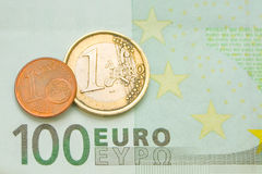 One euro, one cent on one hundred euro bill Royalty Free Stock Photo