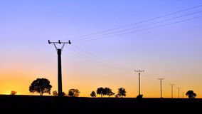 One evening. Countryside with sunset rays and electricity Royalty Free Stock Photos