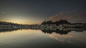 One evening in South Finistere. The day falls on Audierne and the city illuminates Royalty Free Stock Photos