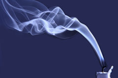 One extinguished candle in the smoke Royalty Free Stock Photo