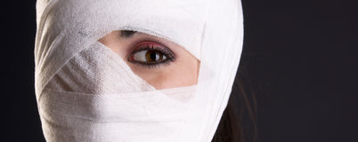 One Eye Showing Through Head Injury Bandage Stock Photography
