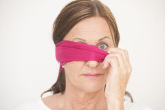 One eye blindfolded woman Stock Photos