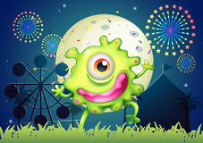 A one-eyed green monster at the amusement park. Illustration of a one-eyed green monster at the amusement park Stock Images