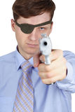 One-eyed robber threatens us with a pistol Stock Images