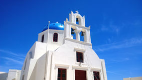 One of the famous blue and white buildings in Oia on Santorini island Royalty Free Stock Images