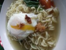 Indomie kaldu plus telur ceplok. One of favorite food in Indonesia. Children, student or employees very like this food stock photography