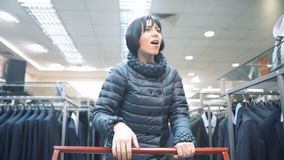 One female person choose cloth for buying from new collections stock footage
