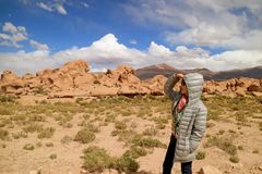 One Female Tourist Looking at the Amazing Landscape with Plenty of Rock Formations in Siloli Desert, High Altitude Expanse of Poto stock image