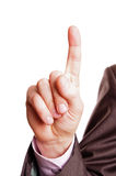 One finger sign. A suited man holding one finger sign on white background Royalty Free Stock Image