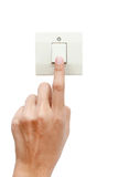 One finger switching turned on off, press the button. White background Royalty Free Stock Photo