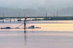 One fisherman on bamboo raft. Fisherman view on bamboo raft rides ng in water Royalty Free Stock Photos