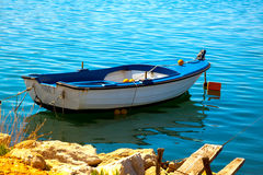 One fishing boat floating Royalty Free Stock Photo