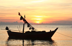One Fishing Boat in sunrise Stock Photos