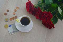 One five euro note with roses and coffee Royalty Free Stock Image