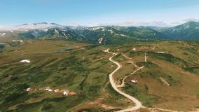 One Flew Over the gorgnoy expensive. A winding path in the mountains. Mountain road in Russian