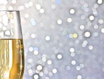 One flute of golden champagne on abstract background Stock Photos