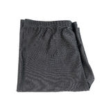 One folding black swimming trunks isolated on white. It is one folding black swimming trunks isolated on white Royalty Free Stock Photography