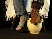 One foot in poverty Royalty Free Stock Images