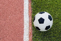 The one football is near the line on the stadium. Stock Photo