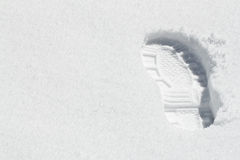 One Footprint Boot in the Snow Royalty Free Stock Photo