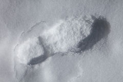 One footprint on snow Stock Photos