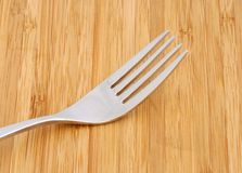 One fork on wood table Royalty Free Stock Photo