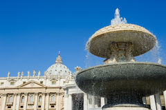 One fountain in St Peter square in Rome, Italy Stock Images