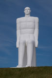 One of four huge White Men statues, Esbjerg, Denmark. Four white men sitting looking at the sea near Esbjerg, Denmark. They are each 9 meters tall and made of Stock Image