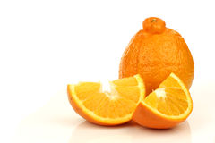 One fresh minneola and some slices. On a white background Royalty Free Stock Photo