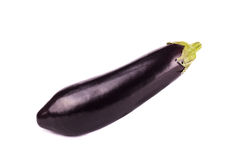 One fresh and raw eggplant over white background. One fresh eggplant over white background Royalty Free Stock Photo