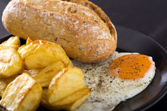 One fried egg with potatoes Stock Image