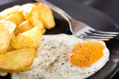 One fried egg with potatoes Royalty Free Stock Photo