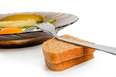 One fried eggs with slices of wholegrain toast Stock Image