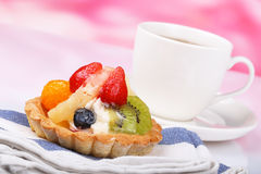 One fruit cake and teacup Stock Image
