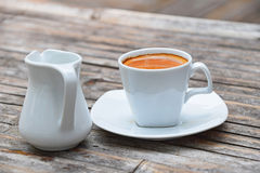 One full cup of espresso coffee on bamboo table Royalty Free Stock Photo