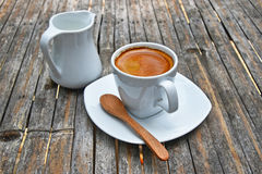 One full cup of espresso coffee on bamboo table Royalty Free Stock Photos