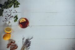 One full cups of black tea with lemon stock photography
