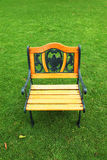 One garden chair on green grass Stock Photography