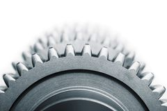 One Gear and blured gears. On white background royalty free stock photo