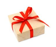 One Gift Christmas Box Wrapped With Kraft Paper And Red Bow Stock Image