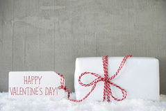 One Gift, Urban Cement Background, Text Happy Valentines Day. One Christmas Gift Or Present On Snow With Red Ribbon. Cement Wall As Background. Modern And Urban stock images