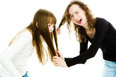 One girl abusing other by pulling her hairs - sister`s love royalty free stock photos