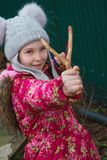 Girl aiming of slingshot. One girl aiming of slingshot Royalty Free Stock Images