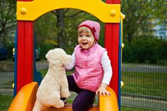 One girl at playground with toy dog Stock Photos