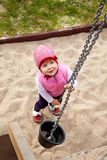 One girl playing at sandbox with pail Royalty Free Stock Photo