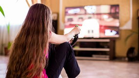 One Girl Playing Video Game Sitting On The Floor stock video